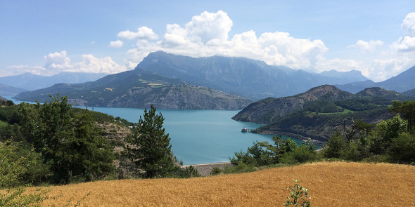 Panoramic view on the lake of Serre-Ponçon, its dam and the Muséoscope